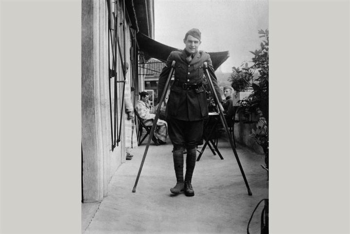 Ernest Hemingway on crutches while recovering in Milan, Italy, 1918