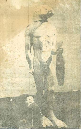man fish sculpture